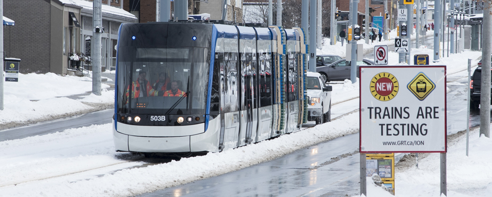 ION train on King Street with testing warning sign