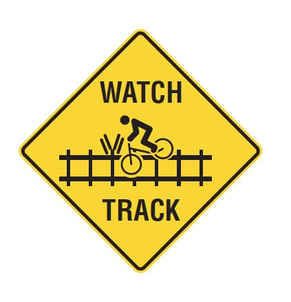 Yellow diamond sign with cyclist crossing railway tracks