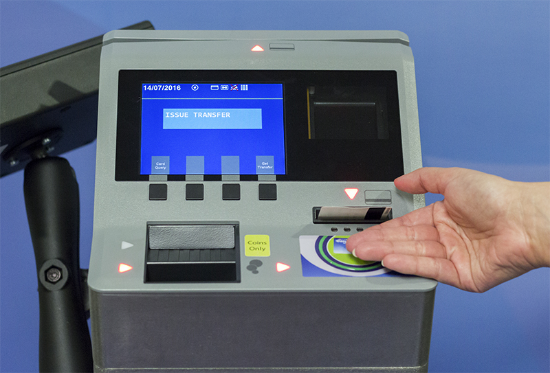 New electronic farebox with hand taking transfer from transfer slot.