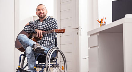 Man in wheelchair with guitar