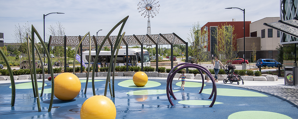 Splash pad at The Boardwalk with bus passing
