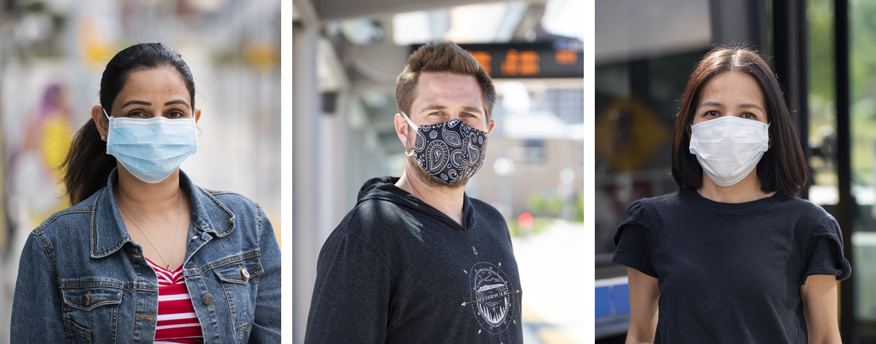 Three people wearing masks at transit stops