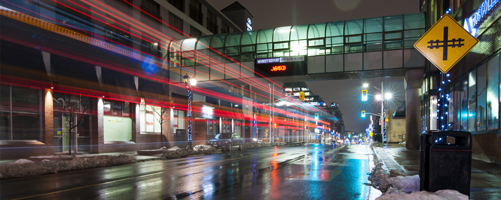 Light trails from bus passing at night on King Street, Kitchener.